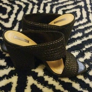 Black woven leather mules
